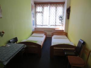 Een bed of bedden in een kamer bij Florenc 41