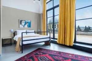 A room at Fabrika Hostel & Suites