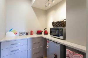 A kitchen or kitchenette at Silversands Beach Cottage