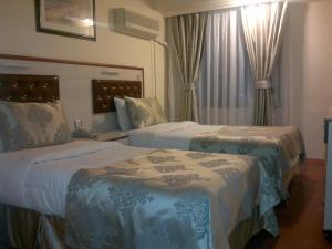 Кровать или кровати в номере Tayhan Hotel