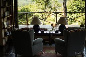 Un restaurant u otro lugar para comer en El Soberbio Lodge