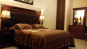 A bed or beds in a room at Hotel Villa Bernal