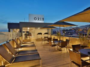 A restaurant or other place to eat at Orla Copacabana Hotel