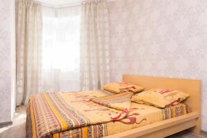 """Кровать или кровати в номере """"SelimVseh"""" at Soyuznaya"""