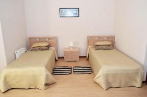 Кровать или кровати в номере Отель Полянка