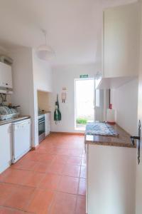 A cozinha ou kitchenette de Casal dos Crespos House