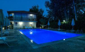 The swimming pool at or close to Studio Nikos