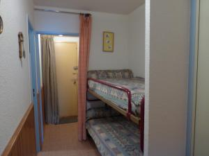 A bunk bed or bunk beds in a room at Cayolle 23
