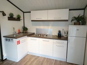 Küche/Küchenzeile in der Unterkunft TCS Camping Bern - Eymatt