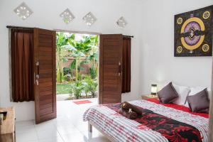 A bed or beds in a room at Naturale Guest House