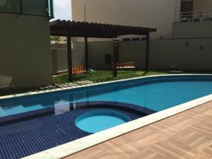 The swimming pool at or close to Manawa Beach Flat - A 24