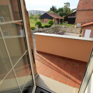 """Ein Balkon oder eine Terrasse in der Unterkunft Fewo-Baunatal / Ferienwohnung """"Am Pilgerbach"""""""