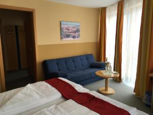 Ein Sitzbereich in der Unterkunft Hotel & Ristorante Passarelli