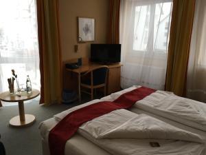 Ein Bett oder Betten in einem Zimmer der Unterkunft Hotel & Ristorante Passarelli