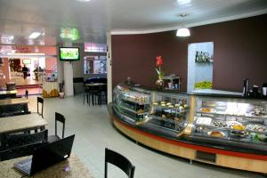 A restaurant or other place to eat at Xikus Palace Hotel