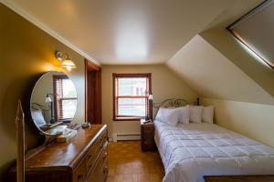 Un ou plusieurs lits dans un hébergement de l'établissement Auberge Mr James