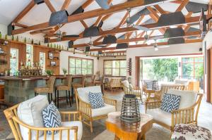 A restaurant or other place to eat at Ka'ana Resort & Spa