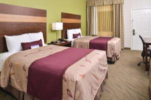 A bed or beds in a room at Americas Best Value Inn Downtown Houston