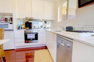 A kitchen or kitchenette at Rubys Oasis @ Bondi Beach