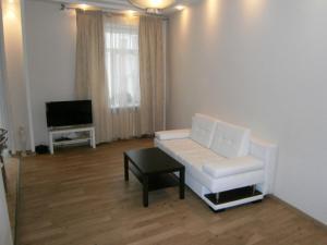 Гостиная зона в Leader NORD apartment on Arbat