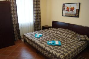 Кровать или кровати в номере Hotel Kurilotransavto