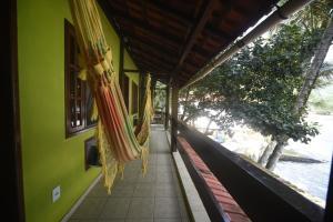 A balcony or terrace at Aquario Pousada Hostel - Night Club