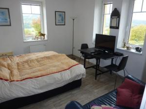 Een bed of bedden in een kamer bij B&B en mini-camping Pension Kidafo
