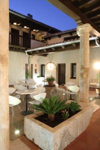 A patio or other outdoor area at Evenia Alcalá Boutique Hotel