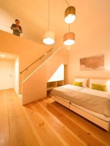 Ein Bett oder Betten in einem Zimmer der Unterkunft OBENauf in Unternalb