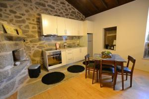 A kitchen or kitchenette at Casas de Porto Bom
