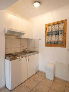 Η κουζίνα ή μικρή κουζίνα στο Pension Laura