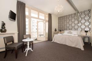 Un ou plusieurs lits dans un hébergement de l'établissement Hotel & Appartementen Bella Vista