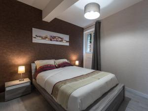 A bed or beds in a room at Appart Hôtel Bourgoin