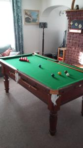 A pool table at Church End Farm Bed and Breakfast
