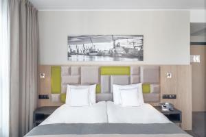 Łóżko lub łóżka w pokoju w obiekcie Hotel Almond Business & SPA