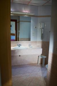 Ванная комната в Hotel Delle Muse