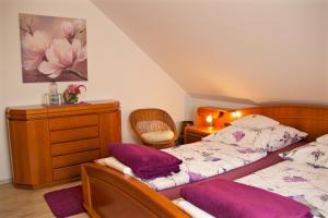 Ένα δωμάτιο στο Ferienwohnungen Engelsgaertchen