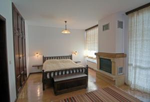 En eller flere senge i et værelse på Holiday Village Kochorite