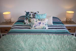 A bed or beds in a room at CHILL-OUT BEACHSIDE @ FORSTER