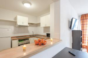 A kitchen or kitchenette at Appart'City Bourg en Bresse