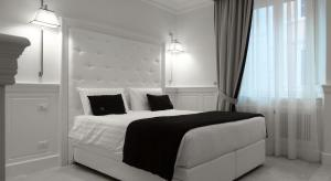 A bed or beds in a room at Hotel Tito