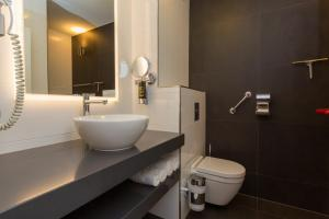 Een badkamer bij Hotel Zonneduin