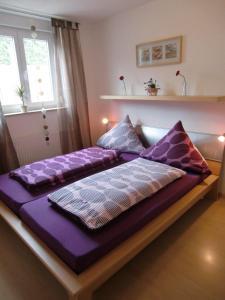 Ein Bett oder Betten in einem Zimmer der Unterkunft Ferienwohnung Tischler