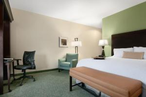 A bed or beds in a room at Hampton Inn Vernon