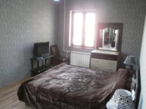 Um quarto em Apartment on Tbilisi Avenue