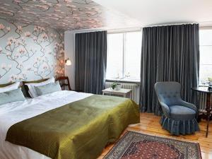 Säng eller sängar i ett rum på Hotell Villa Vesta