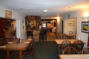A restaurant or other place to eat at The Swan at Great Kimble