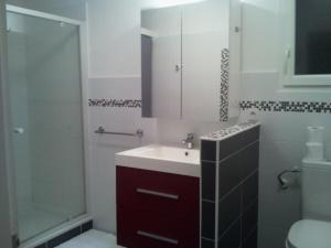 A bathroom at Appartement de charme terrasse solarium au calme