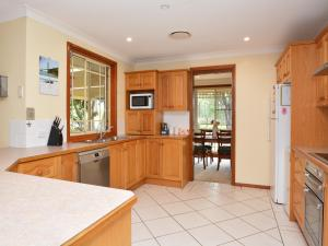 A kitchen or kitchenette at Merewether Homestead with Pool and Family friendly