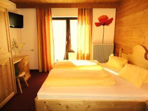 Voodi või voodid majutusasutuse Alpenhof Schwaiger toas